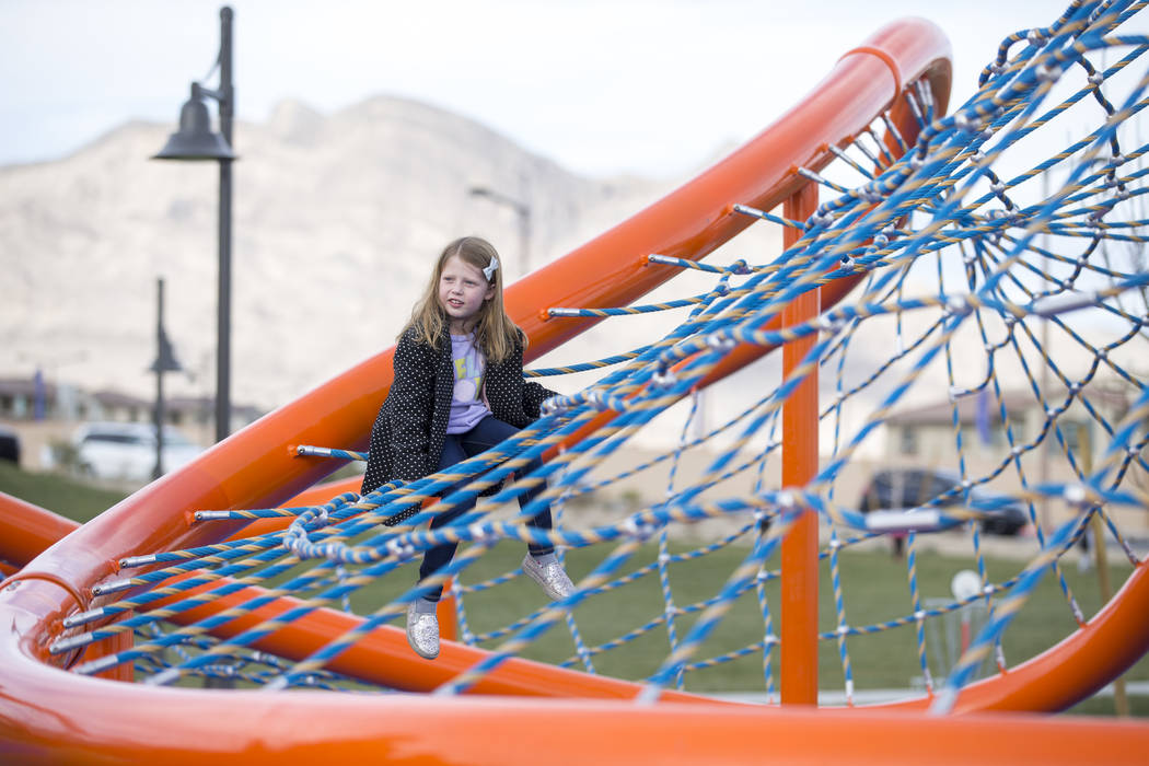 A young girl plays on a giant climbing structure known as 'The Orange Beast' at Summerlin's Fox Hill Park in The Paseos village neighborhood, Saturday, Jan. 6, 2018, in Las Vegas. Richard Brian La ...