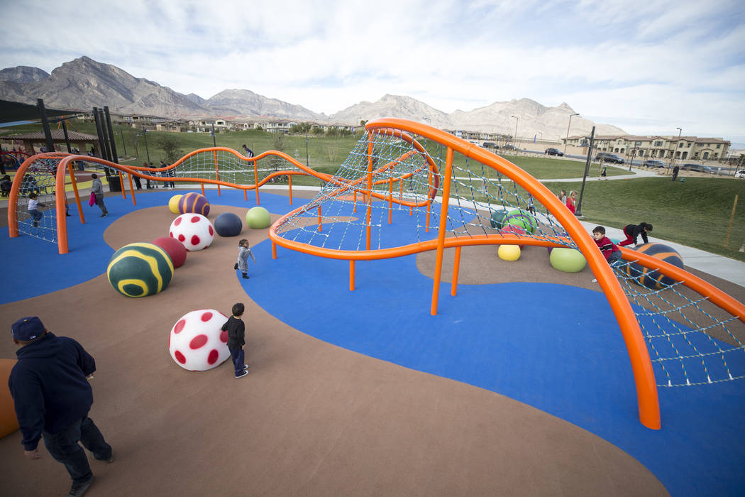 Children play on a giant climbing structure known as 'The Orange Beast' at Summerlin's Fox Hill Park in The Paseos village neighborhood, Saturday, Jan. 6, 2018, in Las Vegas. Richard Brian Las Veg ...
