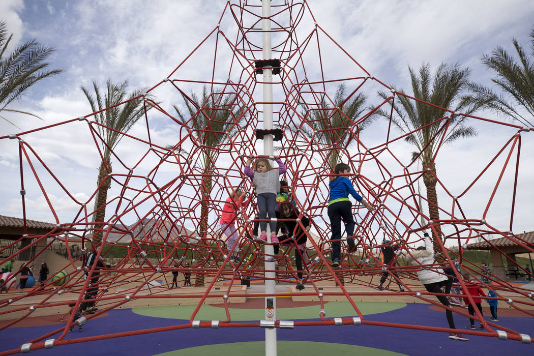 Four-year-old Annika Janik of Las Vegas plays on a 32-foot climbing tower at Summerlin's Fox Hill Park in The Paseos village neighborhood, Saturday, Jan. 6, 2018, in Las Vegas. Richard Brian Las V ...