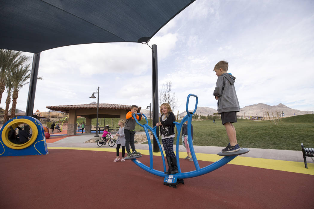 Children play on a teeter-totter at Summerlin's Fox Hill Park in The Paseos village neighborhood, Saturday, Jan. 6, 2018, in Las Vegas. Richard Brian Las Vegas Review-Journal @vegasphotograph