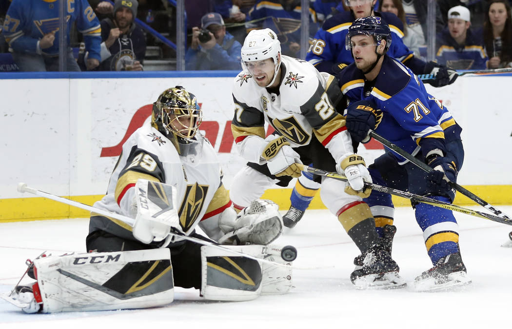 St. Louis Blues' Vladimir Sobotka, right, of the Czech Republic, shoots wide of Vegas Golden Knights goaltender Marc-Andre Fleury, left, as Vegas Golden Knights' Shea Theodore (27) watches during  ...