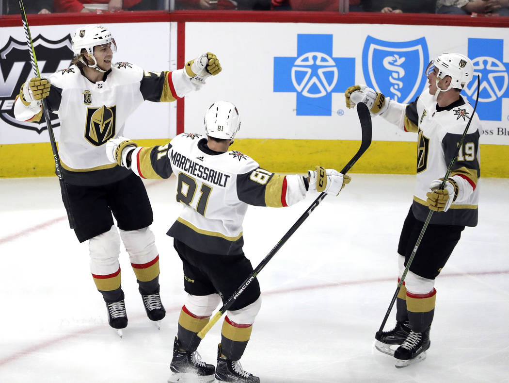 Vegas Golden Knights center William Karlsson, left, celebrates with center Jonathan Marchessault, center, and right wing Reilly Smith after scoring is goal against the Chicago Blackhawks during th ...