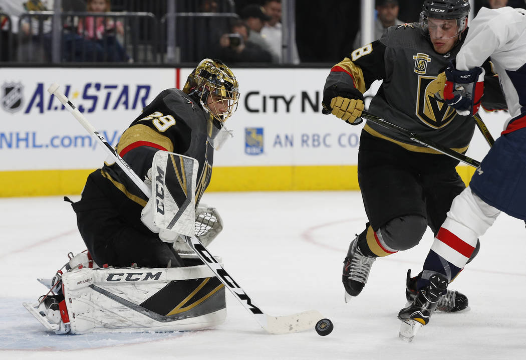 Vegas Golden Knights goalie Marc-Andre Fleury (29) blocks a shot by the Washington Capitals during the second period of an NHL hockey game Saturday, Dec. 23, 2017, in Las Vegas. (AP Photo/John Locher)