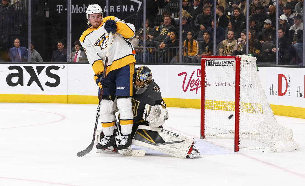 Nashville Predators center Colton Sissons (10) collides with Vegas Golden Knights goaltender Marc-Andre Fleury (29) during the second period of an NHL hockey game between the Vegas Golden Knights  ...
