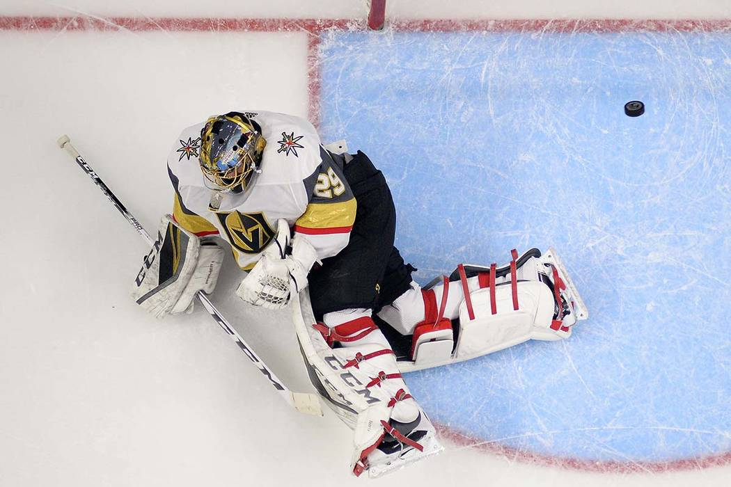 Vegas Golden Knights goalie Marc-Andre Fleury defects a shot during the first period of the team's NHL hockey game against the Los Angeles Kings, Thursday, Dec. 28, 2017, in Los Angeles. (AP Photo ...