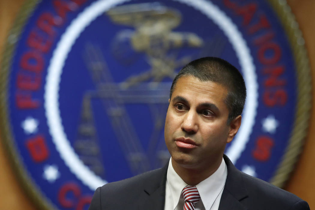 Federal Communications Commission Chairman Ajit Pai arrives for an FCC meeting where they will vote on net neutrality in Washington, Dec. 14, 2017.  Published reports say Pai is skipping the CES g ...