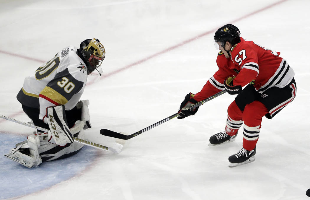Vegas Golden Knights goalie Malcolm Subban, left, blocks a shot by Chicago Blackhawks right wing Tommy Wingels during the first period of an NHL hockey game Friday, Jan. 5, 2018, in Chicago. (AP P ...