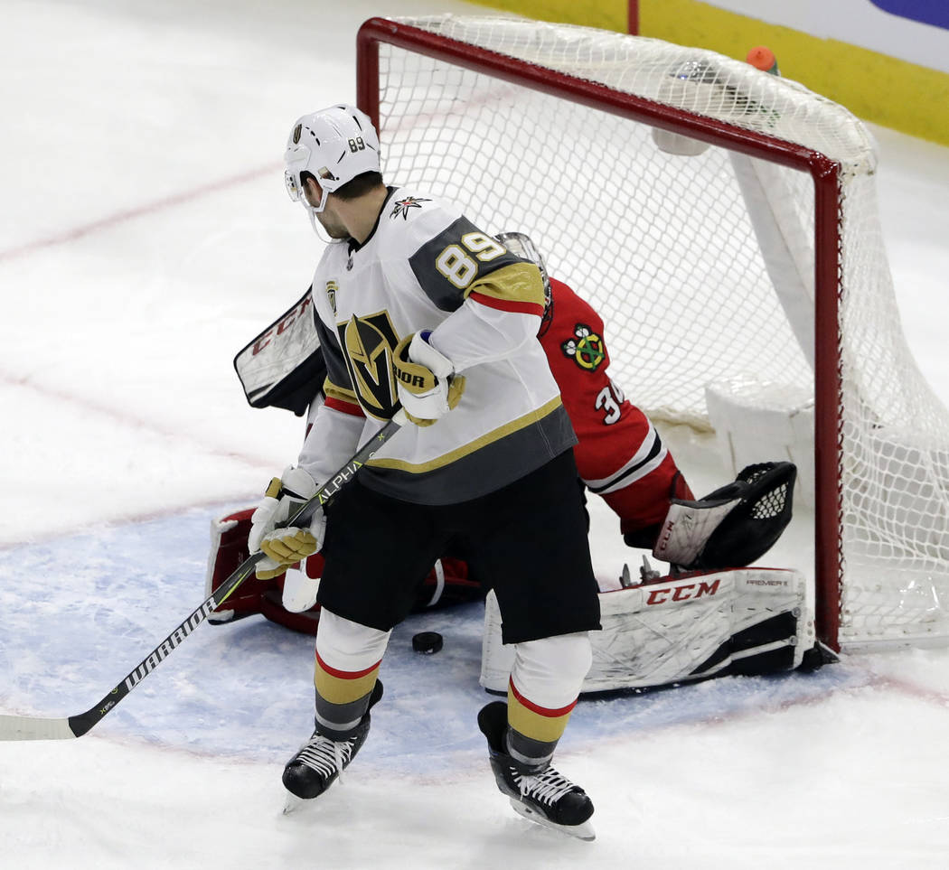 Vegas Golden Knights right wing Alex Tuch (89) scores against Chicago Blackhawks goalie Jeff Glass during the first period of an NHL hockey game Friday, Jan. 5, 2018, in Chicago. (AP Photo/Nam Y. Huh)