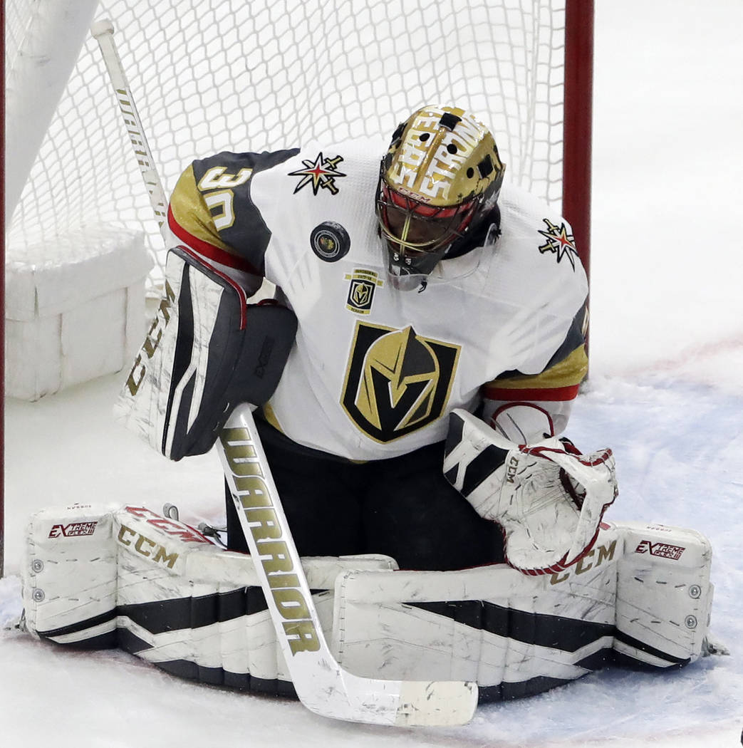 Vegas Golden Knights goalie Malcolm Subban stops a shot by the Chicago Blackhawks during the third period of an NHL hockey game Friday, Jan. 5, 2018, in Chicago. (AP Photo/Nam Y. Huh)