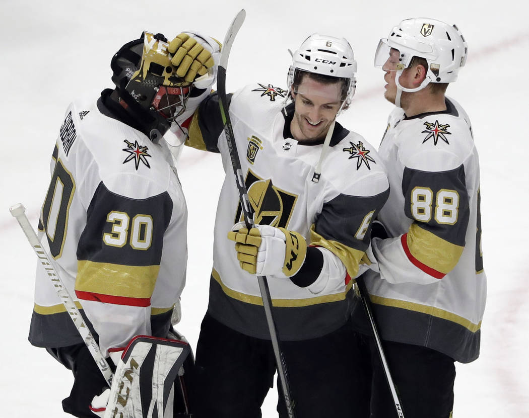 Vegas Golden Knights goalie Malcolm Subban, left, celebrates with defensemen Colin Miller, center, and Nate Schmidt after they defeated the Chicago Blackhawks in an NHL hockey game Friday, Jan. 5, ...