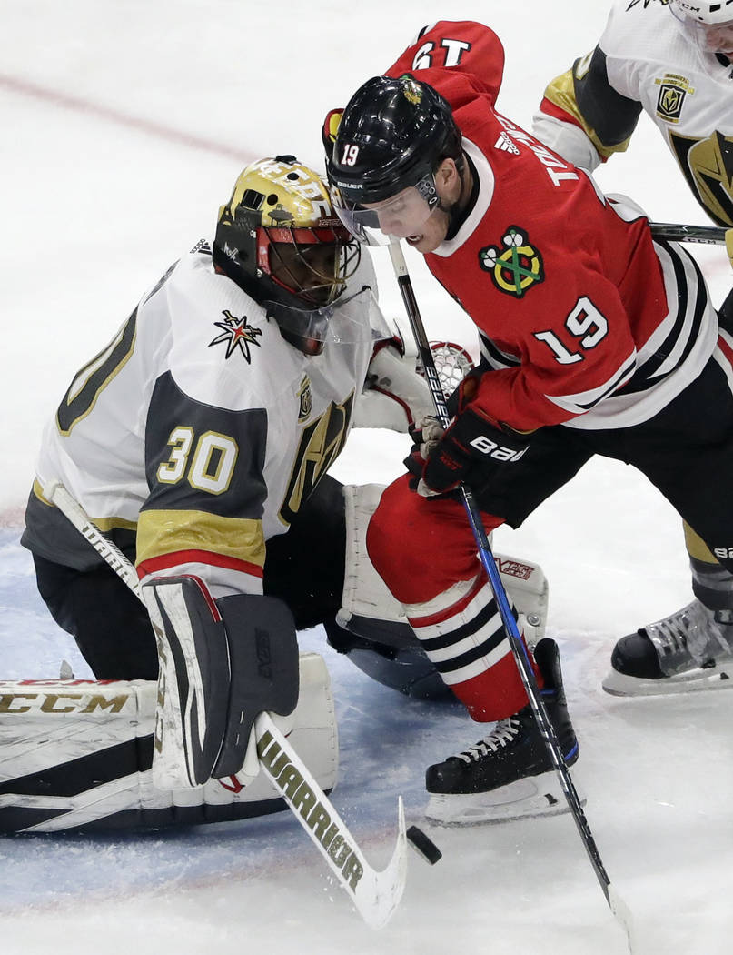 Vegas Golden Knights goalie Malcolm Subban, left, blocks a shot by Chicago Blackhawks center Jonathan Toews during the third period of an NHL hockey game Friday, Jan. 5, 2018, in Chicago. (AP Phot ...