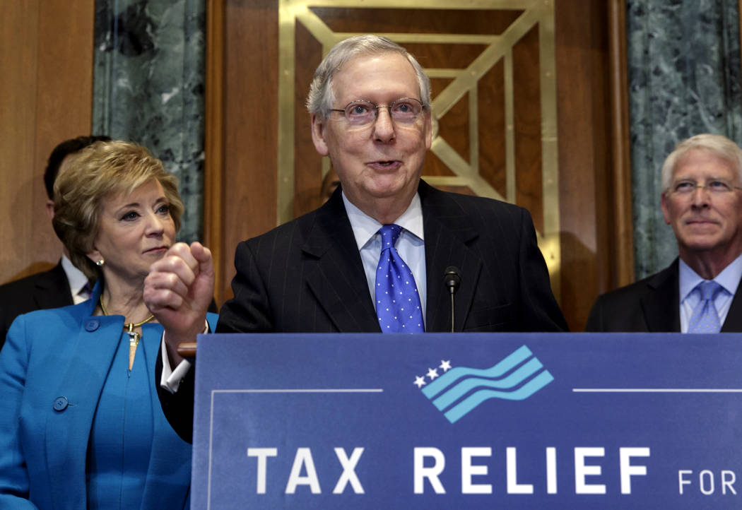 Senate Majority Leader Mitch McConnell, R-Ky., flanked by, Small Business Administration Administrator Linda McMahon, left, and Sen. Roger Wicker, R-Miss., speaks to a group of small business owne ...
