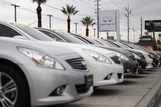 The car lot at Park Place Infiniti in Las Vegas is seen on Tuesday, Oct. 7, 2014. A new program implemented on July 1 by the DMV requires dealerships to use technology and alternative services to  ...