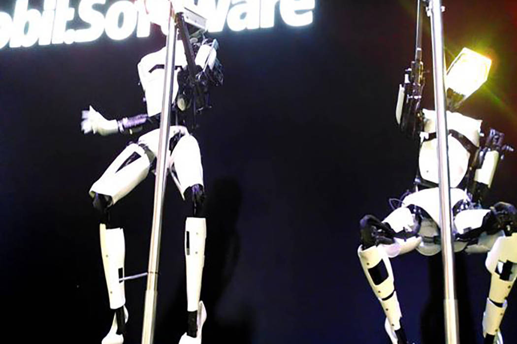 Pole-dancing dancing robots created by U.K. artist Giles Walker will be on display at Sapphire Las Vegas next week during the Consumer Electronics Show. (Giles Walker/Facebook)
