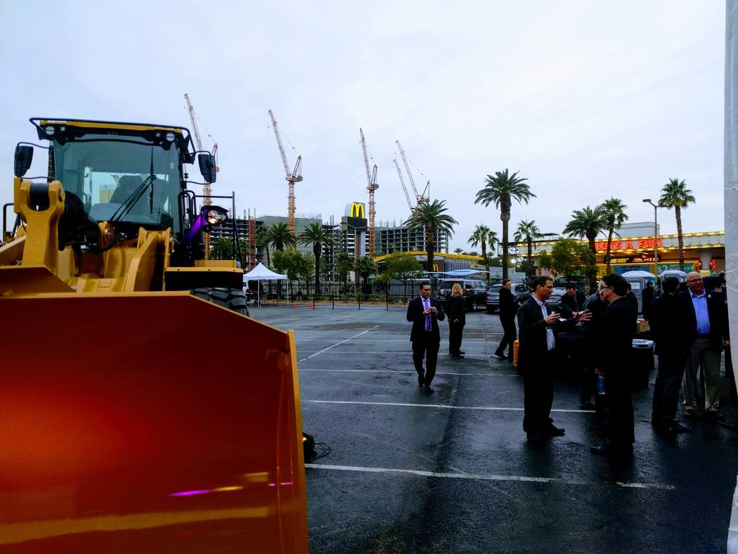 A crowd gathers Monday, Jan. 8, 2018, in Las Vegas, Nev., prior to the groundbreaking for the $1.4 billion expansion of the Las Vegas Convention Center. Tower cranes at the site of Resorts World L ...