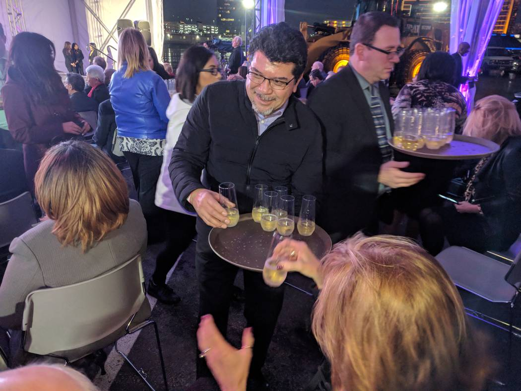 Wait staff serve a Champagne toast after a ceremonial groundbreaking on Monday, Jan. 8, 2018, for an expanded Las Vegas Convention Center in Las Vegas, Nev. The expanded facility will be complete  ...