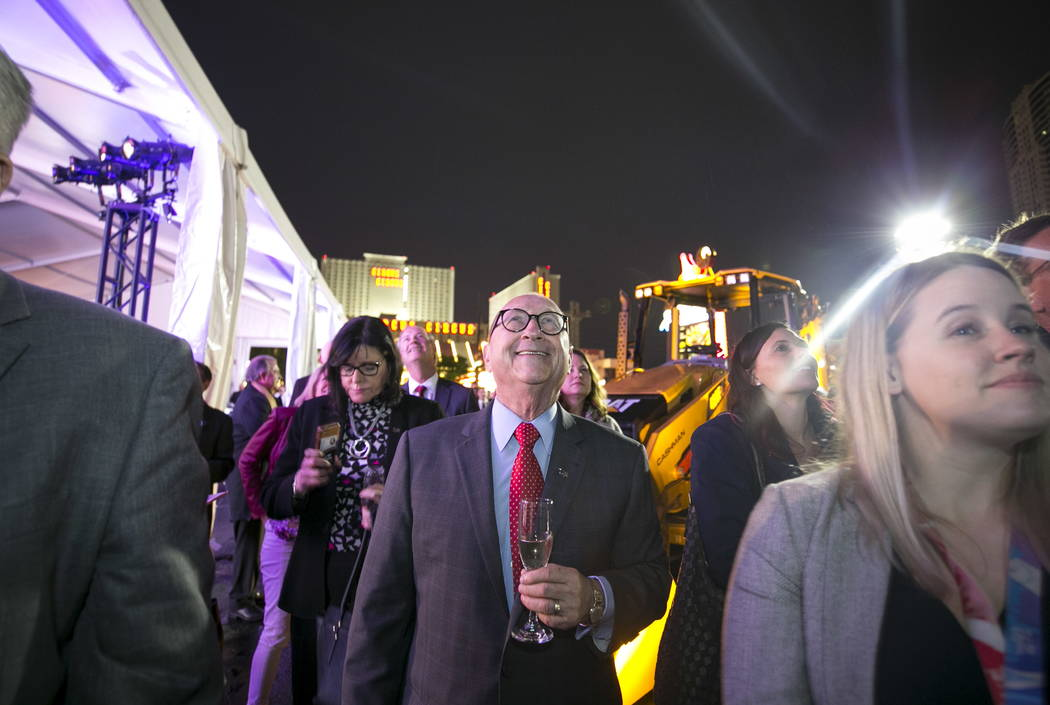 Las Vegas Convention and Visitors Authority President and CEO Rossi Ralenkotter, center, watches a small fireworks display, Monday, Jan. 8, 2018, during a groundbreaking ceremony for a 600,000-squ ...