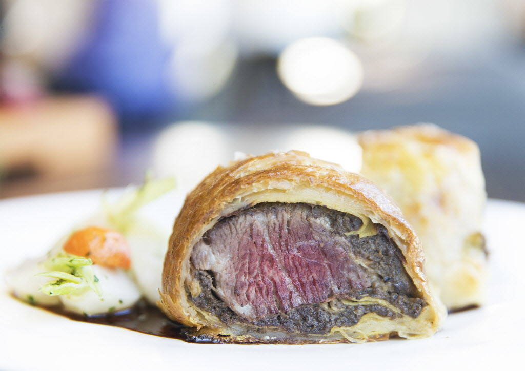 Beef Wellington with potato puree, glazed root vegetables and red wine demi-glaze at Hell's Kitchen on Sunday, January 7, 2018, at Caesars Palace hotel-casino, in Las Vegas. Benjamin Hager Las Veg ...