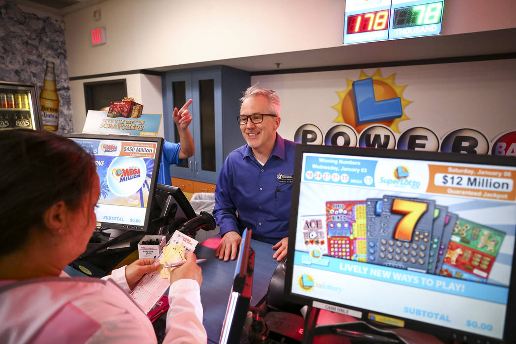 Director of Retail Brian Matherly sells lottery tickets to Las Vegas resident Angelique Leary at The Lotto Store at Primm just inside the California border next to the Primm Valley Casino Resorts  ...