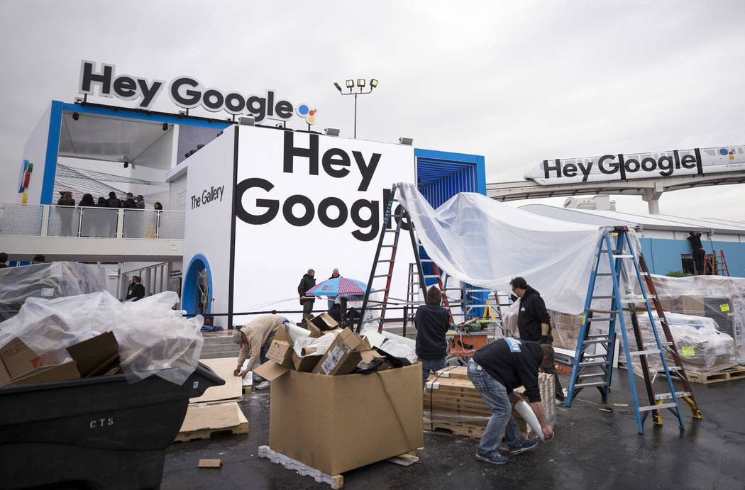 Work continues at the Google booth outside the Las Vegas Convention Center during setup for CES on Monday, Jan. 8, 2018, in Las Vegas.