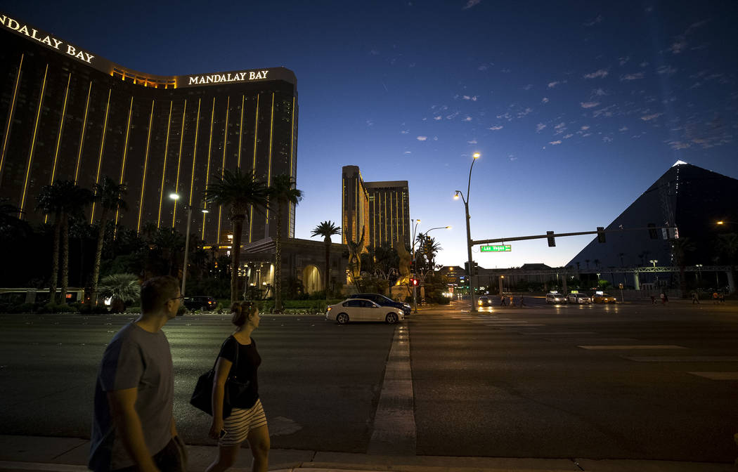 People walk past the Mandalay Bay on the Vegas Strip at dusk on Wednesday, Oct. 11, 2017. Richard Brian Las Vegas Review-Journal @vegasphotograph