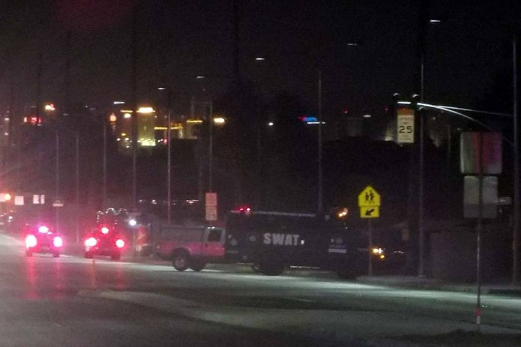 A SWAT truck parked outside a neighborhood where a knife-wielding man was barricaded on the roof of a home. (Max Michor/Las Vegas Review-Journal)