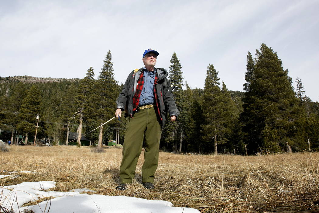 Frank Gehrke, chief of the California Cooperative Snow Surveys Program for the Department of Water Resources, looks over a nearly snow barren meadow while conducting the first snow survey of the s ...