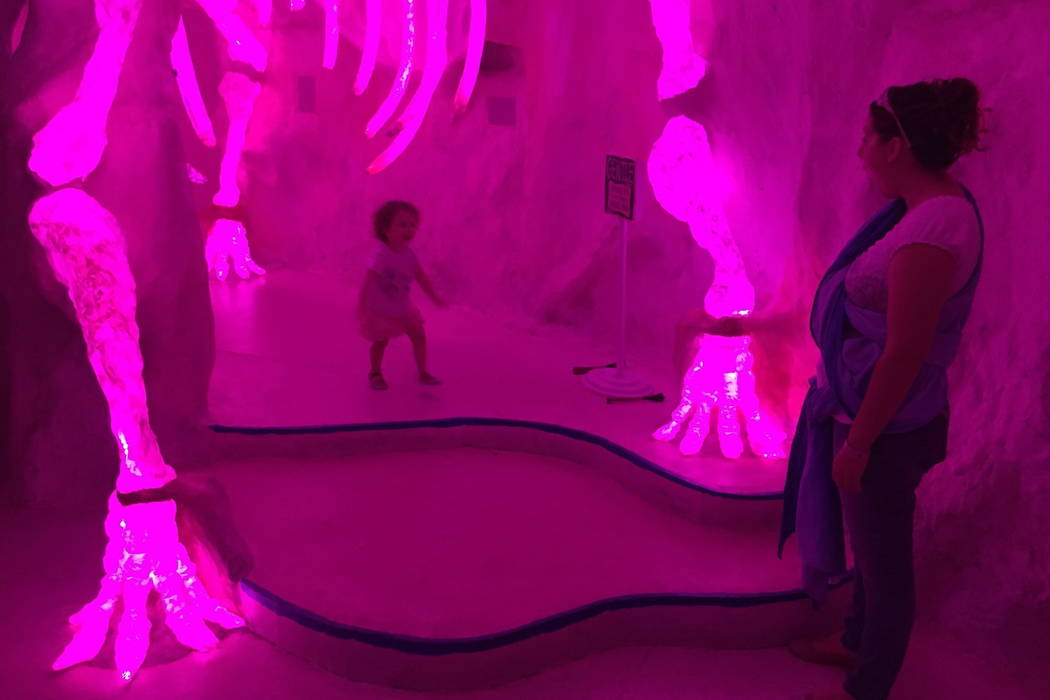 Caryn Saeger, 28, of Delta, Ohio, and her 2-year-old daughter Chloe explore Meow Wolf's mazelike exhibition space in Santa Fe, N.M., in 2017. (AP Photo/Morgan Lee, File)