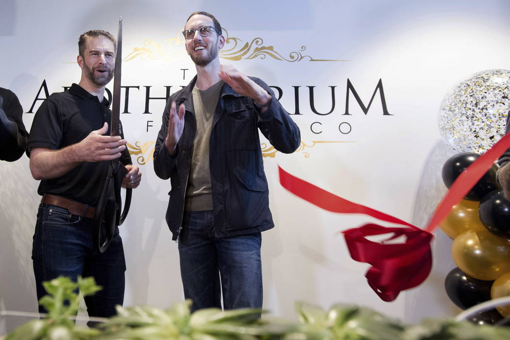 California State Sen. Scott Weiner, right, celebrates the opening of The Apothecarium for recreational marijuana sales with company co-founder and CEO Ryan Hudson in San Francisco on Saturday, Jan ...