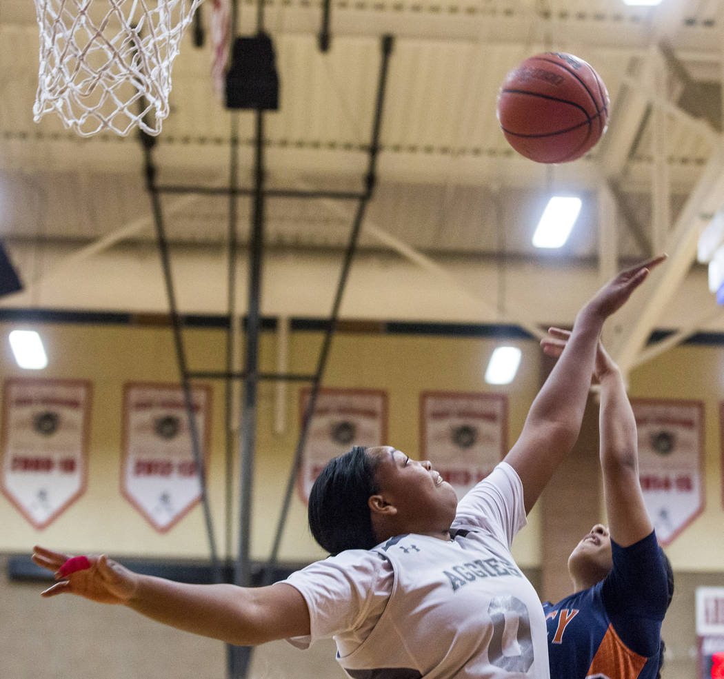 Legacy's Taeha Pankey attempts a layup while Arbor View's Autumn Westmoreland attempts to block her at Arbor View High School on Thursday, Jan. 11, 2018. Legacy won 53-39. Patrick Connolly Las Veg ...