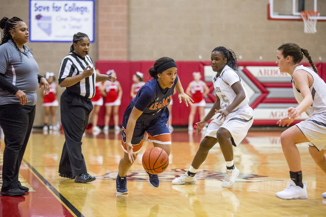 Legacy's Taeha Pankey attempts to out dribble Arbor View players at Arbor View High School on Thursday, Jan. 11, 2018. Legacy won 53-39. Patrick Connolly Las Vegas Review-Journal @PConnPie