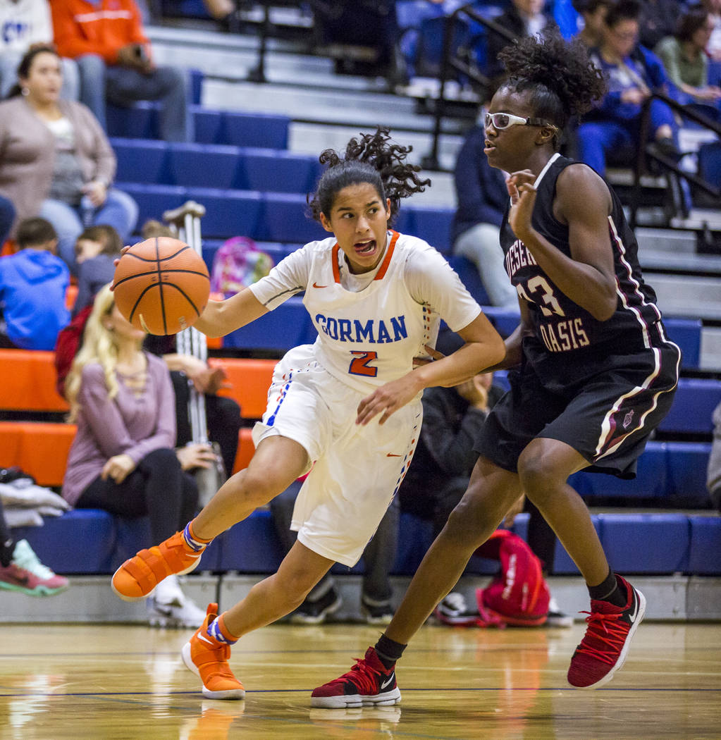 Bishop Gorman's Shaira Young attempts to dribble past Desert Oasis' Desi-rae Young at Bishop Gorman High School on Friday, Jan. 12, 2018. Desert Oasis won 69-61. Patrick Connolly Las Vegas Review- ...