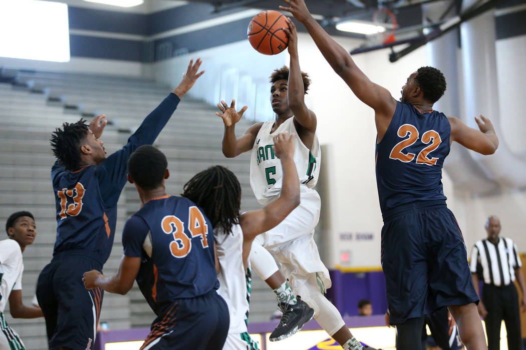 Rancho's Devan Wright (5) goes up for a shot against Legacy in the boy's basketball game at Durango High School in Las Vegas, Saturday, Jan. 13, 2018. Erik Verduzco Las Vegas Review-Journal @Erik_ ...