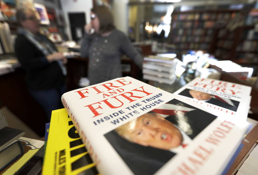 "Copies of the book ""Fire and Fury: Inside the Trump White House"" by Michael Wolff are displayed at Barbara's Books Store Friday, Jan. 5, 2018, in Chicago. (AP Photo/Charles Rex A ..."