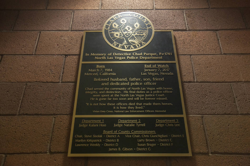 A plaque in honor of Detective Chad Parque at a memorial at North Las Vegas Justice Court in Las Vegas, Tuesday, Jan. 9, 2018. Parque was killed one year ago in a car accident while on duty. Rache ...