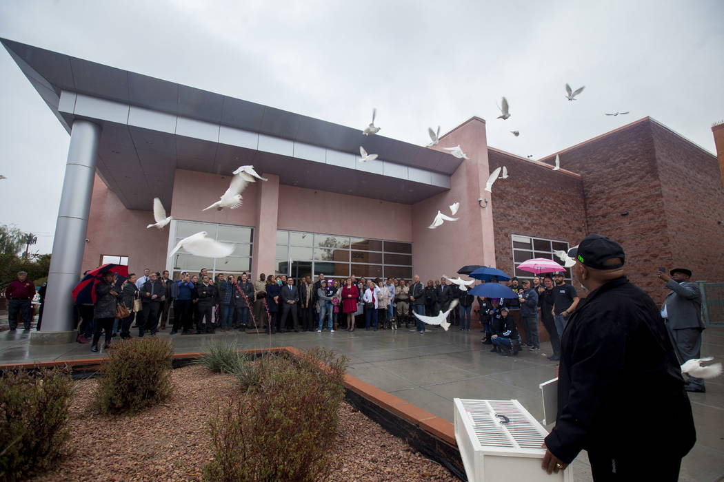 Willie Sims releases doves in honor of Detective Chad Parque at a memorial at North Las Vegas Justice Court in Las Vegas, Tuesday, Jan. 9, 2018. Parque was killed one year ago in a car accident wh ...