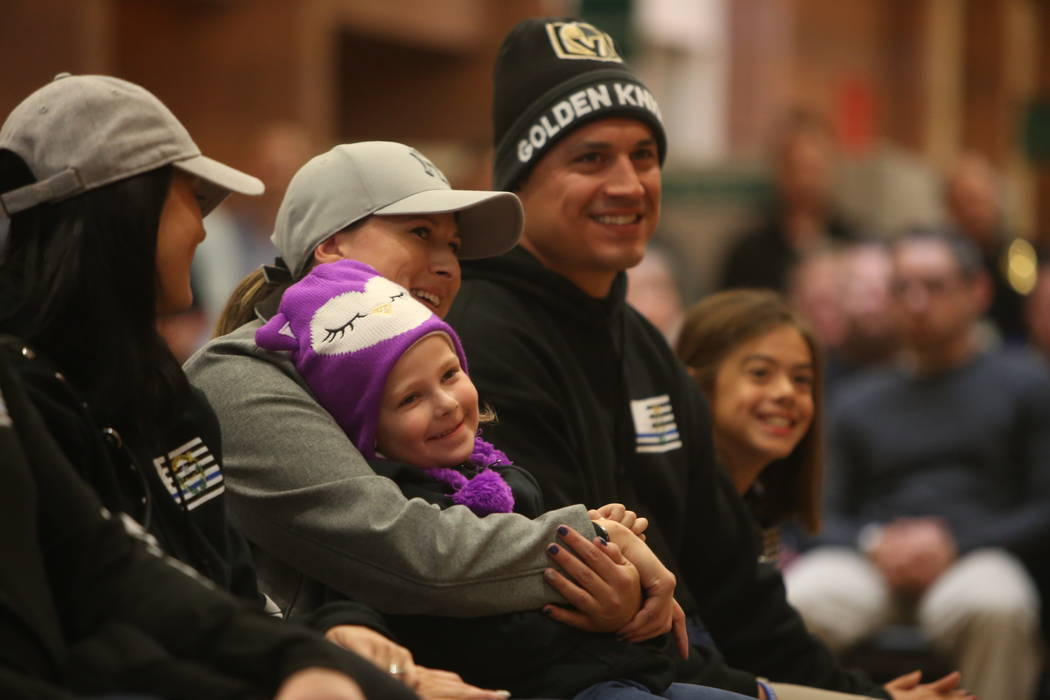 The widow of Detective Chad Parque, Jessica Parque, sits with her daughter Riley Parque, in the front row at a memorial in honor of her late husband at North Las Vegas Justice Court in Las Vegas,  ...