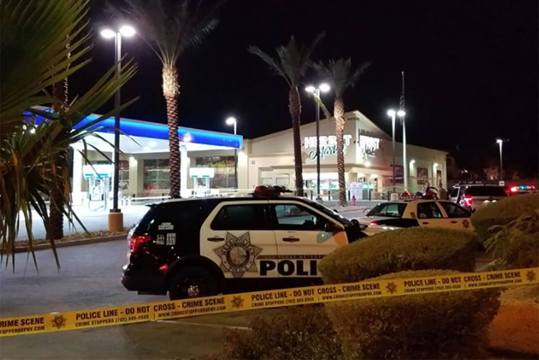 Police work the scene of a fatal shooting at Herbst Market in Las Vegas on Saturday, Jan. 6, 2018. (Mike Shoro/Las Vegas Review-Journal)