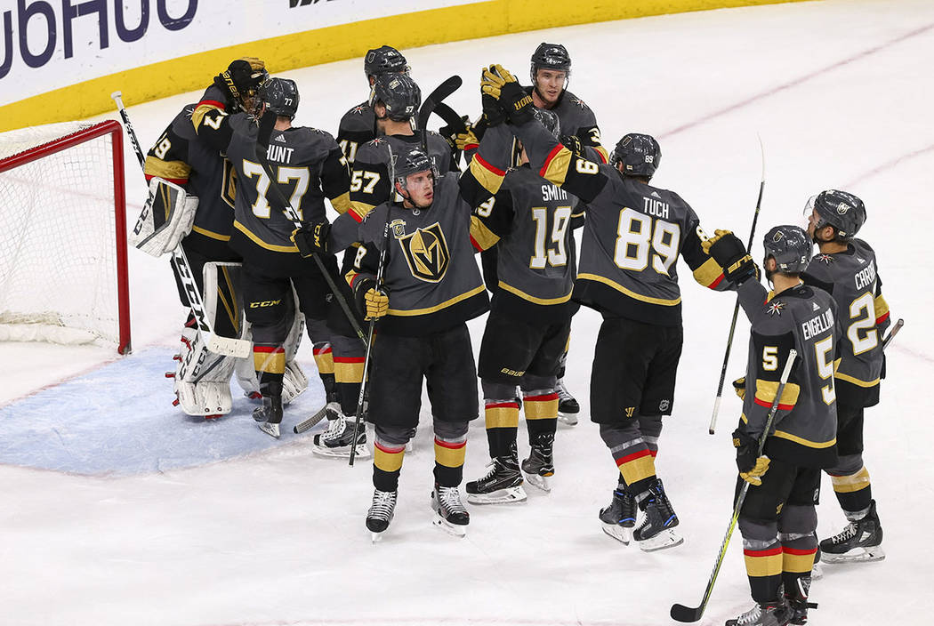 Members of the Vegas Golden Knights celebrate their 2-1 victory over the New York Rangers at the T-Mobile Arena in Las Vegas, Sunday, Jan.  07, 2018. Richard Brian Las Vegas Review-Journal @vegasp ...