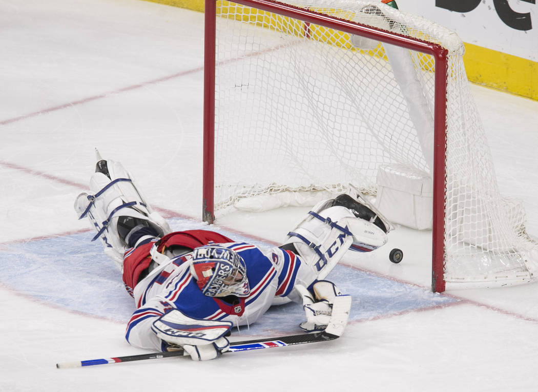 A shot by Vegas Golden Knights center William Karlsson gets past New York Rangers goaltender Ondrej Pavelec (31) during the third period of an NHL hockey game between the Vegas Golden Knights and  ...