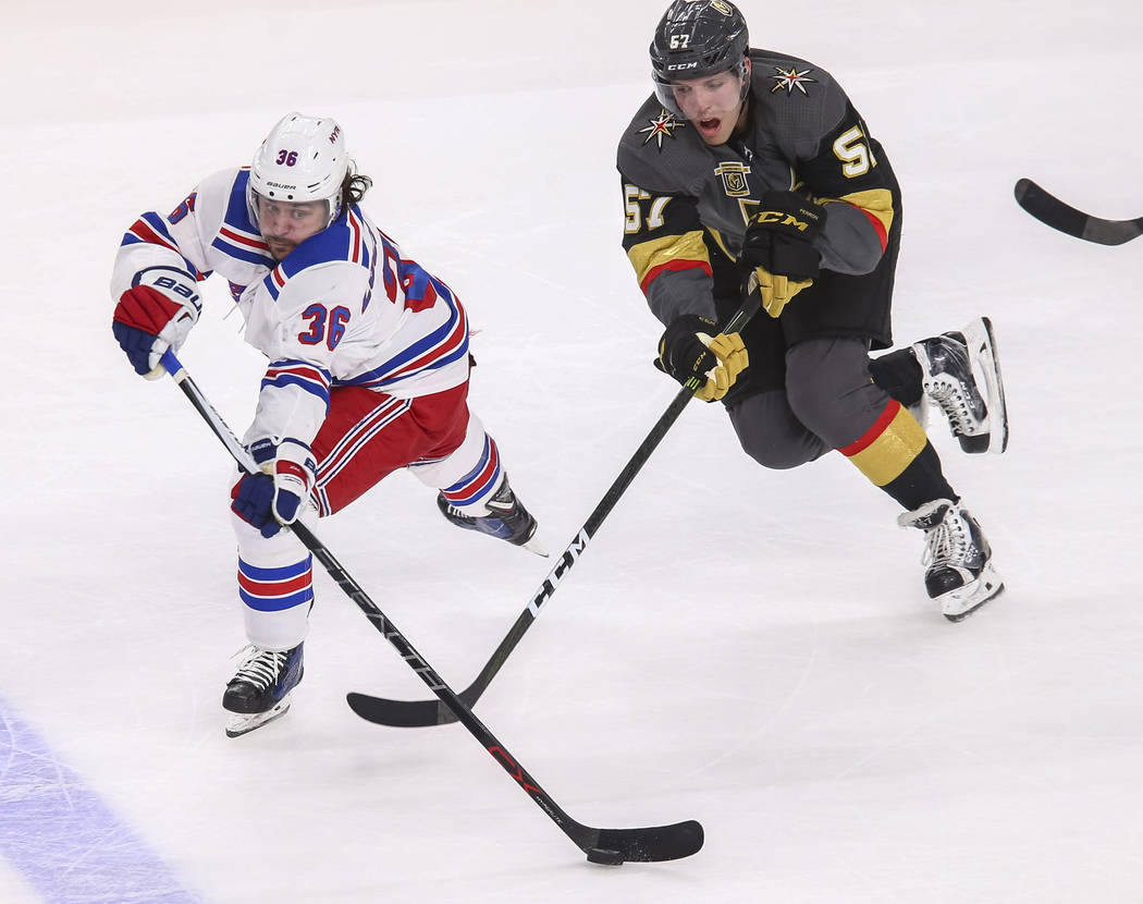 New York Rangers right wing Mats Zuccarello (36) and Vegas Golden Knights left wing David Perron (57) vie for the puck during the third period of an NHL hockey game between the Vegas Golden Knight ...