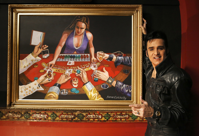 "Steve Connolly, who performs as Elvis in ""Spirit of the King"", with his painting (acrylic on wood) at Four Queens hotel-casino on Saturday, Dec. 17, 2016 in Las Vegas. According  ..."