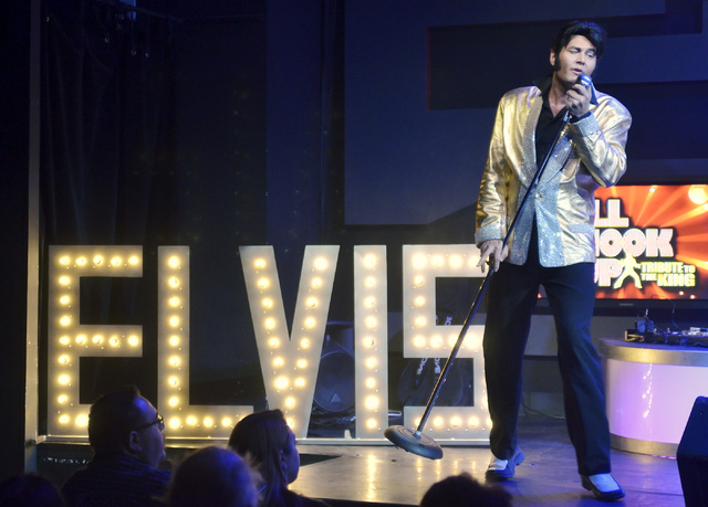 "Travis Allen performs as Elvis Presley during ""All Shook Up"" at the V Theater in the Miracle Mile Shops at the Planet Hollywood hotel-casino at 3667 Las Vegas Blvd., South, on Th ..."