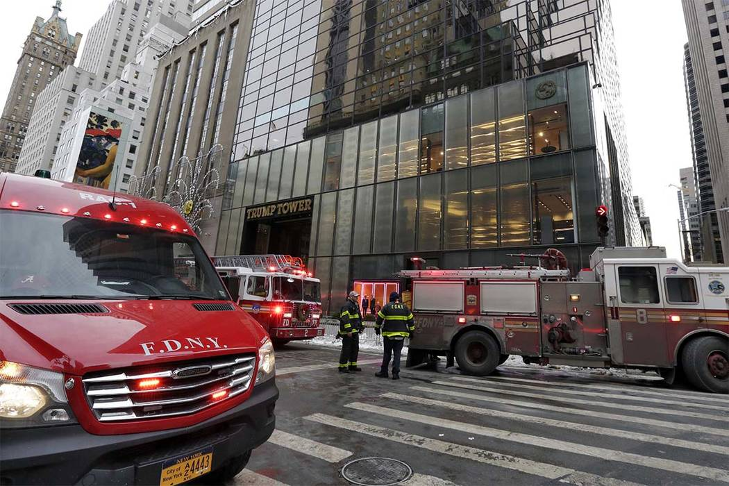 New York City Fire Department vehicles sit on Fifth Avenue in front of Trump Tower, in New York, Monday, Jan. 8, 2018. The department said a fire started around 7 a.m. Monday in the heating and ai ...