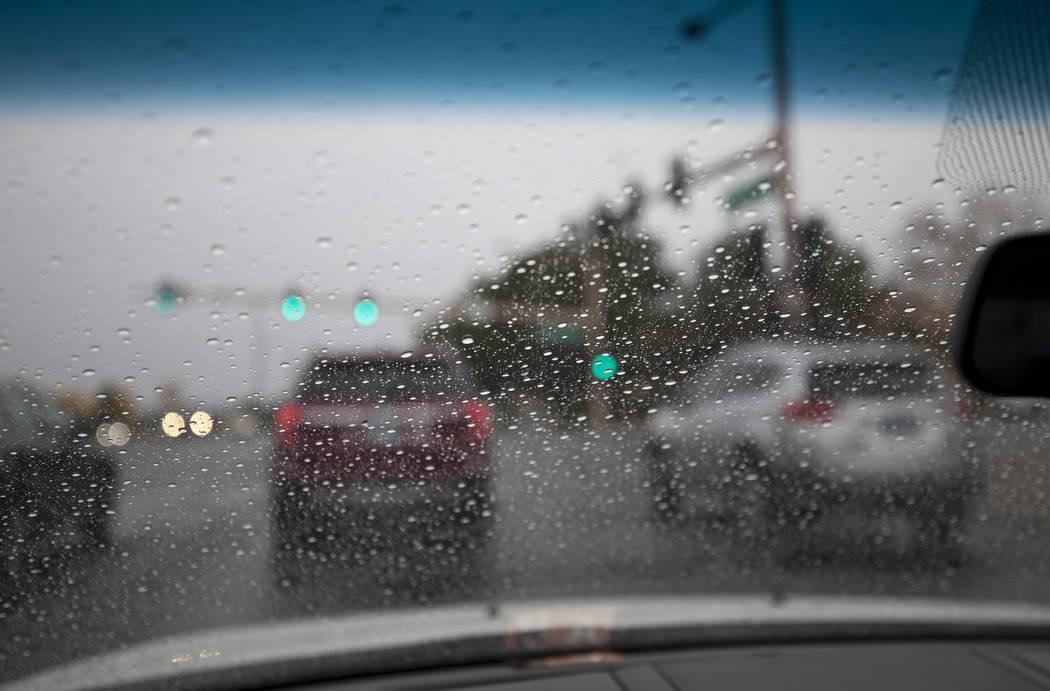 Rain begins to pour near W. Sahara Avenue and S. Hualapai Way in Las Vegas on Monday, Jan. 8, 2018. Richard Brian Las Vegas Review-Journal @vegasphotograph