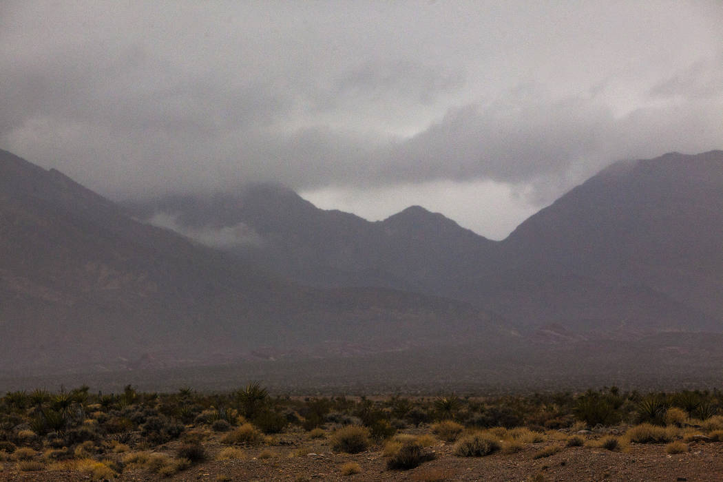 The edge of mountains with cloud cover in the northwest area of Las Vegas, Monday, Jan. 8, 2018. Rain hit Las Vegas Monday morning, the first time in nearly four months, and stayed intermittent th ...