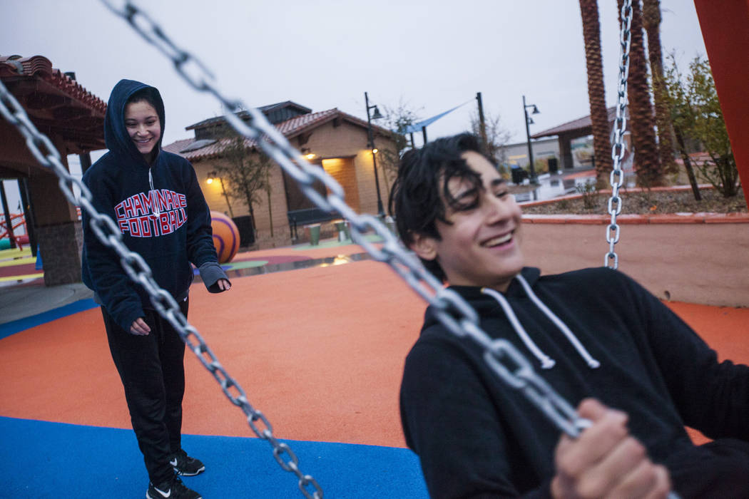 Giulianna Navarro pushes her brother Alejandro Navarro, 15, on a swing in the rain at Fox Hill Park in Las Vegas, Monday, Jan. 8, 2018. Rain has returned to the Las Vegas Valley Monday for the fir ...