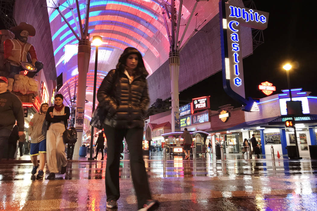 A pedestrian crosses Fourth Street in downtown Las Vegas during a light rain on Monday, Jan. 8, 2018. David Guzman Las Vegas Review-Journal @DavidGuzman1985