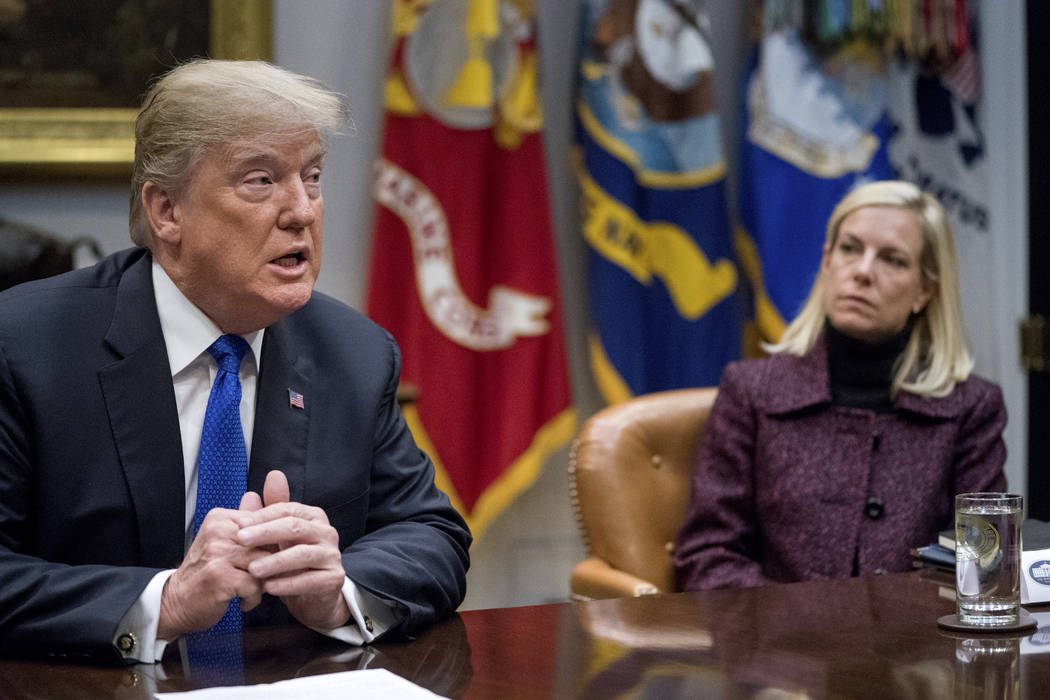 President Donald Trump, accompanied by Secretary of Homeland Security Kirstjen Nielsen, speaks during a meeting with Republican senators on immigration in the Roosevelt Room at the White House in  ...
