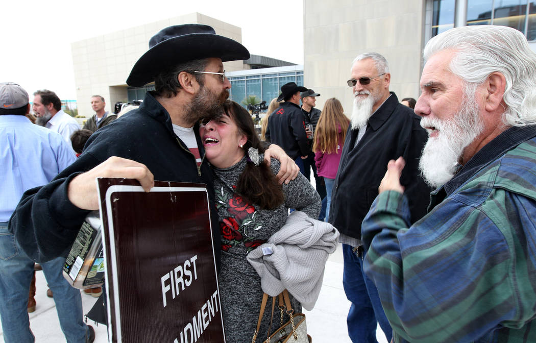 Cliven Bundy supporters Greg Whalen and Maggie Rose McGrath hug outside Lloyd George U.S. Courthouse in Las Vegas Monday, Jan. 8, 2017, after a federal judge dismissed the case with prejudice agai ...